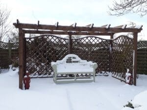 A bench in a snowdrift at Abbots Green in North Yorkshire